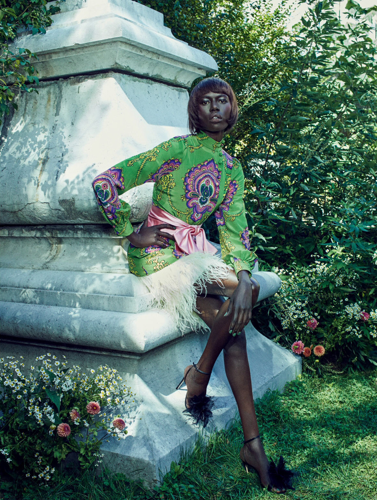Ajak Deng Poses In A Blooming Paradise for ELLE UK