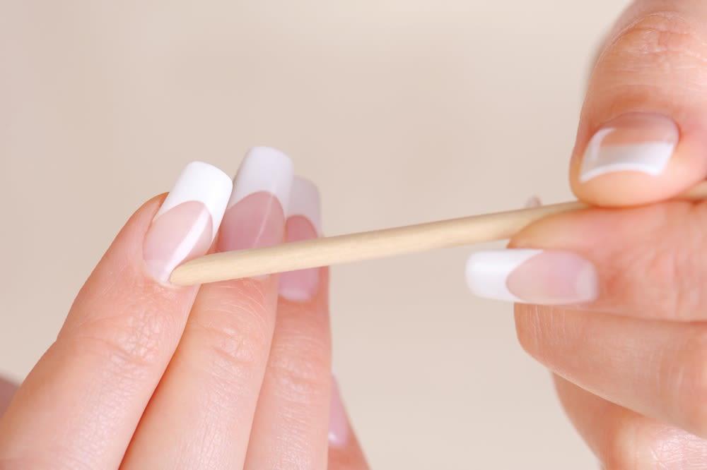 dreamstime-nails-manicure-cuticle-pusher-orange-stick | BN Style